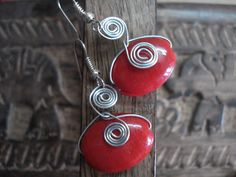 red stones set in wire spirals. visit www.facebook.com/throughcreativeeyes/ to order or send me a message!