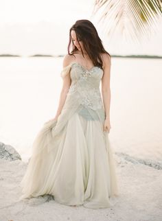 This bride chose a seafoam green gown | Islamorada Wedding on Style Me Pretty  | http://stylemepretty.com/2013/05/02/islamorada-wedding-from-kt-merry-photography| Photography by KT Merry