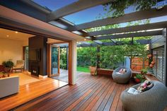 This is an elegant backyard design of the modern house. In this awesome designing, the designer has done his job very well. An exquisite fusion of artificial beauty with the natural is so smartly balanced in this project. A unique wooden pergola is designed here with a wooden deck under it.