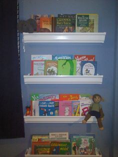 DIY Rain-gutter Bookshelves for $30 am doing this this week for the ends of my bookshelf, need someplace for the kindle and leappad as well as books and remotes!