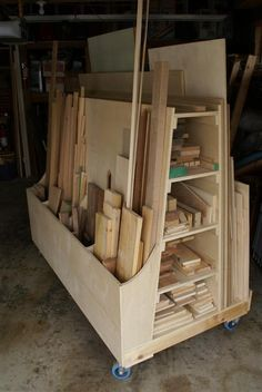 DIY: Lumber Storage System Tutorial ~ This is awesome! The slots allow you to organize horizontally  vertically, keeping lumber off the floor  similar lumber together  its on casters!!!