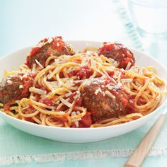 Hearty slow-cooked meatballs simmered in a homemade sauce and served over spaghetti.