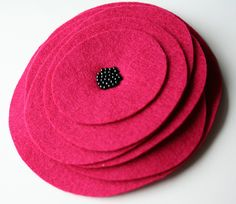 Versatile felt flower package topper.  Would be nice in many colors, too.