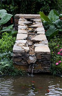 Image detail for -raised design used as a feature to flow into a pond,