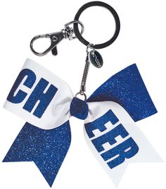 This mini bow keychain packs a lot of spirit with its glitter fabric and CHEER print. Clip this mini glitter cheer bow keychain to your favorite cheer bag.