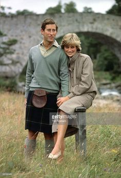 August 19, 1981: Prince Charles And Princess Diana Holding Hands And Smiling As They Pose During A Honeymoon Photocall By The River Dee. The Princess Is Wearing A Tweed Suit Designed By Bill Pashley With A Pair Of Cream Shoes From The Chelsea Cobbler.