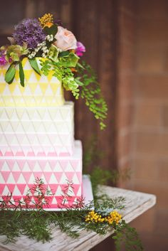 Such a pretty cake with pink and yellow triangles and fresh flowers. Source: Colin Cowie Weddings. #weddingcakes #pink #yellow