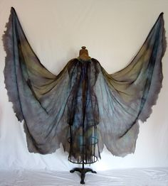 wings to DIY. sheer cape, with dowels attached to hold onto.