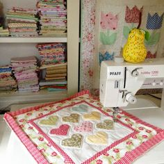 Use fat quarters, scraps, and even mini charm packs to create this lovable Sweetheart Mini Quilt Pattern.