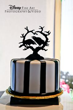 This bewitching cupcake tower topper is wickedly delightful #Disney #wedding #cake #black #crows