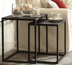 "Burke Nesting Side Table #potterybarn Crafted from blackened iron in simple cube shapes, our Burke tables have the bold character of industrial fixtures. The nesting tables are ideal for smaller spaces. Small: 17"" square, 21.25"" high Large: 20"" square, 24.25"" high Crafted of iron. Small table nests completely under large table. Finished in a matte black."