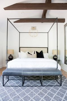 "On the Casita bedroom: ""For the Casita bedroom, we used a thin frame canopy bed from Restoration hardware and mimicked those lines with a leather-and-iron bench from One Kings Lane. To..."