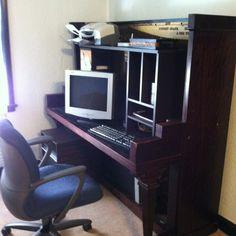 Upright piano repurposed into computer desk.