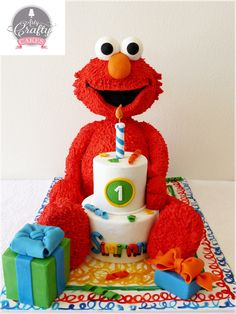 Carved Elmo Cake with a small tiered cake and a...