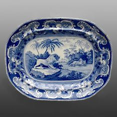 Printed British Pottery & Porcelain   Platter - An earthenware platter printed in blue with a pattern known as Lions. In this example, the male lion on the left was copied from the frontispiece of A Cabinet Of Quadrupeds by John Church, 1805, and the female lion and her cubs on the right were probably copied from History of the Earth and Animated Nature by Oliver Goldsmith, 1811 edition.