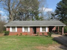 SOLD!!!30 minutes notice to show.All brick ranch in the city limits of Monroe on .43 acre woodedprivate lot.This home offers three bedrooms 1 full bath family room kitchen and laundry room.This home  has laminate flooring throughout. 1 car carport for parking.If you are looking for a sturdy built ranch please dont miss out on this one  .Sold as-is where-is  no repairs. Estate Owned. Equal Housing Opportunity.
