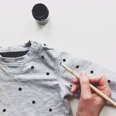 DIY polka dots: just fabric paint and the eraser end of a pencil! May have to try this..