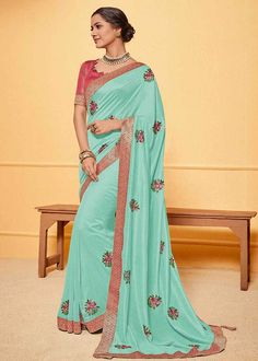 Turquoise Color Jute Silk Party Wear Saree Product Details : Saree color is turquoise. Fabric of this designer saree is jute silk. Comes along with raw silk unstitched blouse. Saree has lace border. Ideal for wedding function, party function, festi Jute Silk Saree, Art Silk Sarees, Indian Sarees Online, Trendy Sarees, Blue Saree, Designer Sarees Online, Latest Sarees, Traditional Sarees, Party Wear Sarees