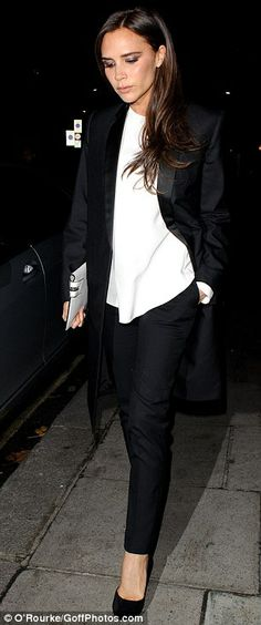 Simple: Victoria opted for a monochrome ensemble which was a change from her usual pencil dress