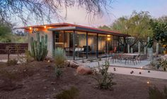 The Barn Guest House looks out over an outdoor entertaining patio, bocce ball court, jacuzzi, and cacti-studded gardens.