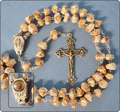 I have a rosary just like this. It is from Medjugore and is made from rocks at the sight of the apparitions of Our Lady. What a treasure to pray with these.