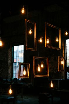 hanging frames and bulbs, photo by Tory Williams http://ruffledblog.com/georgia-railroad-museum-wedding #weddingideas #reception