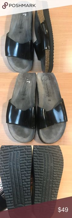 Black patent Mephisto slip on comfort sandals Black patent leather slip on sandals. Marked size 38. Look like they have been worn once, , and leather shows some gentle wear. In excellent used condition. Marked eu 38. Cork footbed and rubber sole. Mephisto Shoes Sandals
