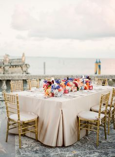 gold chairs, cluster floral centerpieces