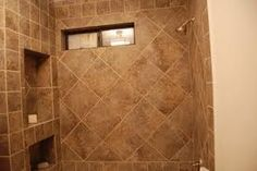 All tan and brown shower remodel