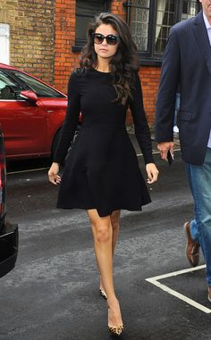 Walk It Out from Selena Gomez's Street Style  Selena tops off her fit-and-flare black frock with a sharp pair ofJimmy Choo sunglasses.