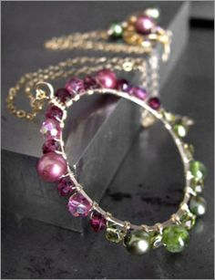 Handmade gemstone hoop pendant necklace with earthy green vessonite, pink and green freshwater pearls, magenta garnet on gold chain.