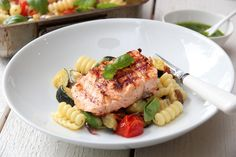 Grilled salmon with pasta, vegetables and pesto