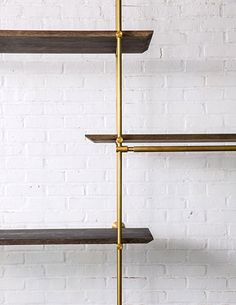 The Collector's Shelving System options include: Hanging Strap Shelf Support, Posting Strap Shelf Support, Knife Edge Detail, LED Light Bar, and completely adjustable Brass Shelving Supports. Brass Shelving, Modern Shelving, Minimalist Shelving, Retail Shelving, Modular Shelving, Adjustable Shelving, Joinery Details, Shelving Systems, Led Light Bars