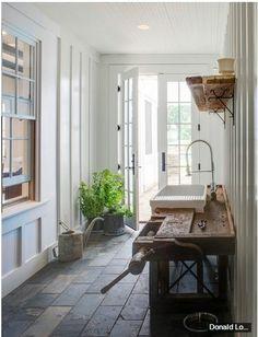 slate floor, interior window, rustic work bench