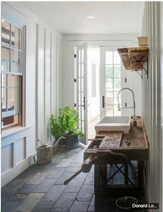 slate floor, interior window, rustic work bench