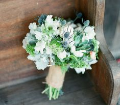 white and blue bouquet of thistles, scabiosa and dusty miller