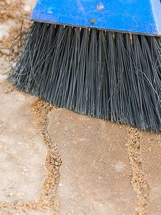 Fill spaces between pavers with builder's sand or polymer sand. Because polymer sand acts like mortar when it's wet, it will keep pavers more firmly in place than traditional sand. It also discourages weeds and keeps sand from washing over pavers after rainstorms. Sweep off excess sand after you fill the spaces.