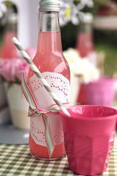 soda bottle decor: doilies and a little grosgrain, so cute
