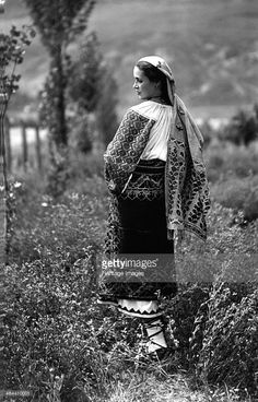 Young woman in traditional costume, Bistrita Valley, Moldavia, north-east Romania, c1920-c1945. Depicting customs and traditional labour in the rural Carpathian Mountains in the first half of the 20th century. The main occupations in this area were the timber industry and livestock farming. The local community were Orthodox Christians who led a very conservative lifestyle.
