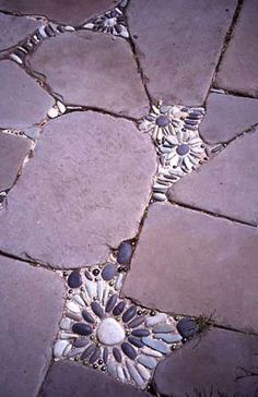 Patio and path examples from rock, pebbles, bricks, and other hardscape materials.