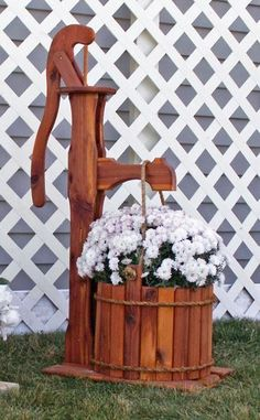 Amish Cedar Decorative Pump Planter with Bucket - Large Place your favorite flowers in this attractive best selling pump planter for some cozy country style outdoors! #planters #outdoorplanter