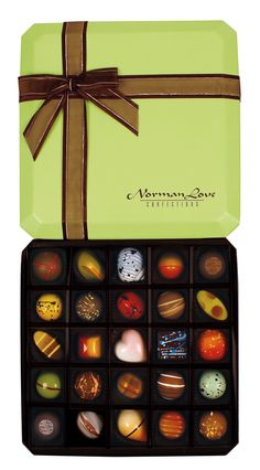 In honor of @princesscruises partnership with chocolatier, Norman Love, we're giving away a 25-piece assortment of @normanlove 's Signature Collection chocolates! #chocolates #entertowin #giveaway #normanlove