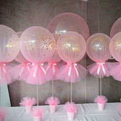 Love these confetti and tulle balloons with gold acrylic initial for a baby…