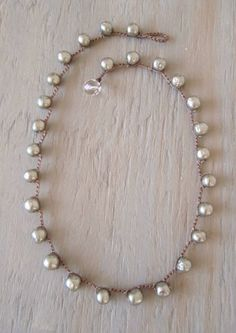 Like her style of jewelry. Vintage designer Pearl crochet necklace 'Coco', dimpled faux pearls, rare silver gray, ultra luxe elegant boho, classic & timeless. $135.00, via Etsy.