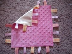 """How to Make a """"Tag-Along"""" Blanky or """"Taggy Blanky"""" 1. First you need to cut two 12 1/2 inch squares of fabric- preferably something soft a..."""