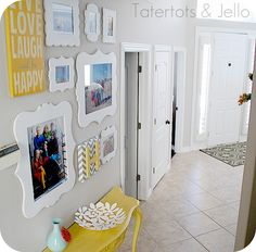 Like the idea of creating a family gallery wall on a open hallway wall.  She used 3M Command Strips to hang the pictures. I like the pop of color on the console table as well!