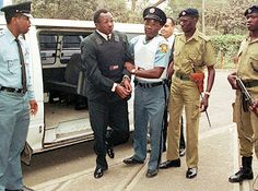 A hand-cuffed Jean-Paul Akayesu, 45, entered a UN tribunal in 1998 in Tanzania, where the former mayor of Taba, in Rwanda, was found guilty of genocide. A member of the Hutu tribe, he urged local residents to murder 2,000 rival Tutsis during the Rwandan civil war. He was the first person convicted of genocide by an international court and was sentenced to life imprisonment.