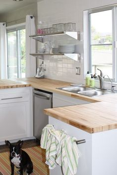 Butcher block counter top    Like the open shelving for dishes!