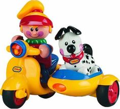 Tolo Toys First Friends Scooter with Puppy by Reeves (Breyer) Int'l. $24.89. Play Matters Award. Nursery World Equipment Award. Practical Pre-School Award. Collectable. Parents Choice Award. From the Manufacturer                Triangle shaped with suction cups on the bottom for secure installation on any smooth surface. Tolo Toys award winning designs, bright colors and cute characters make growing up fun. Specially designed to stimulate a child's interest and curiosity, these ...