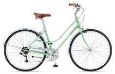 Giant Via 2 step through - Classic styling in mint green with fenders, 8 speeds, 60's style leather saddle and matching grips on a moustache handlebar.